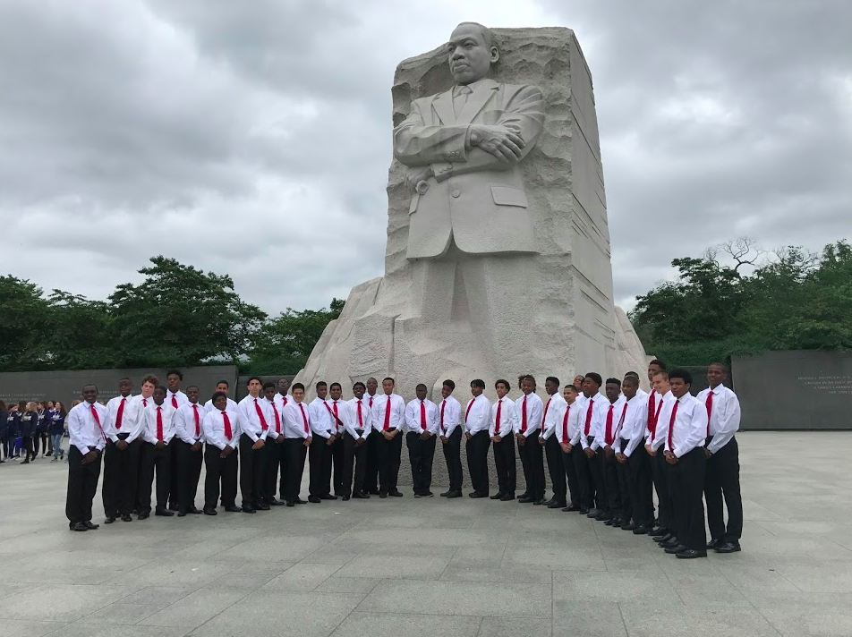 Students posing in front of the MLK Memorial in Washington, D.C.