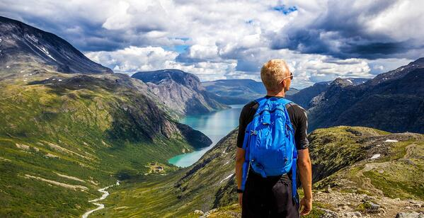 Man looking over fjord in Norway.