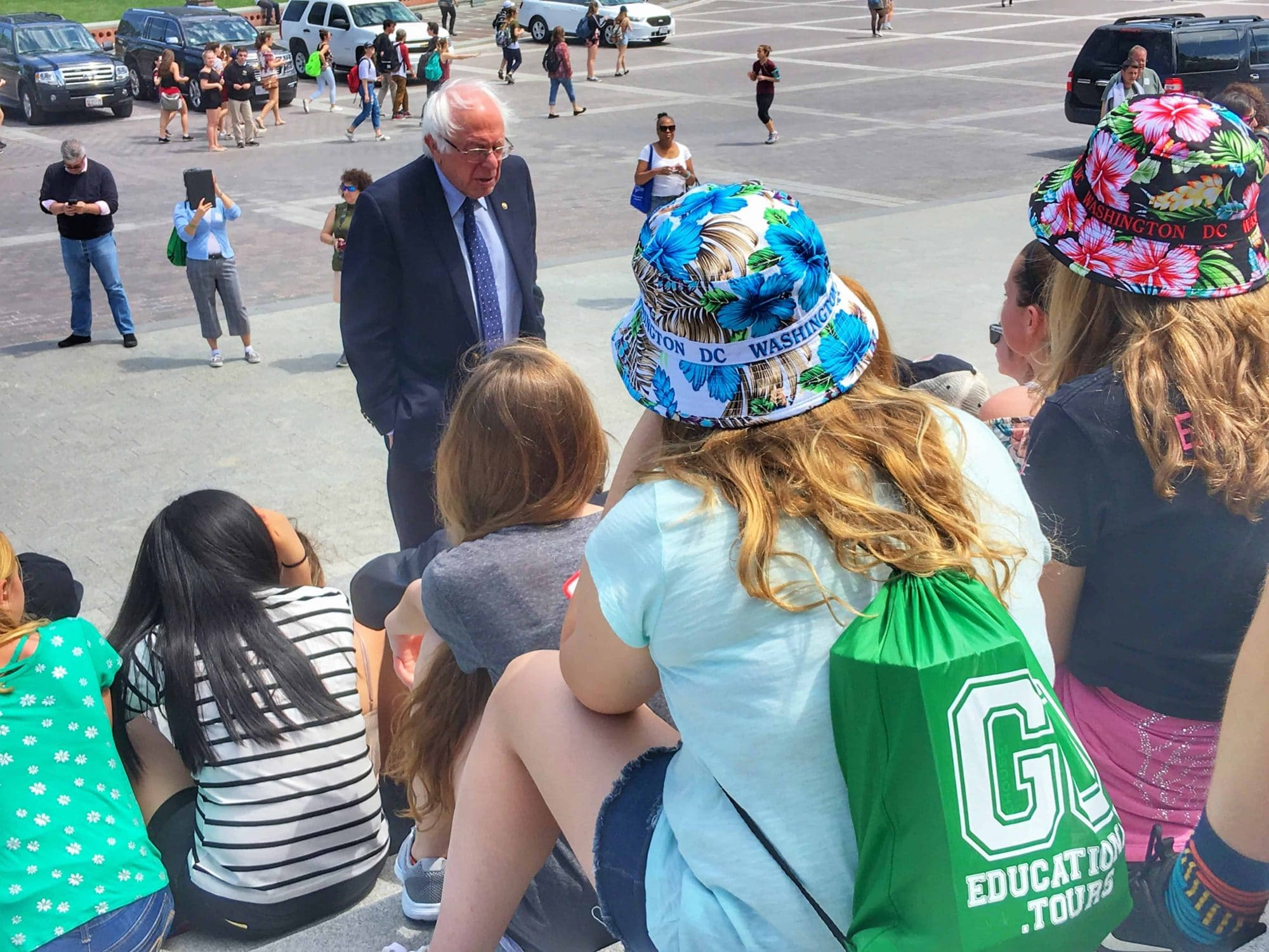 Senator Bernie Sanders on the steps of the US Capitol meeting with students on a class trip