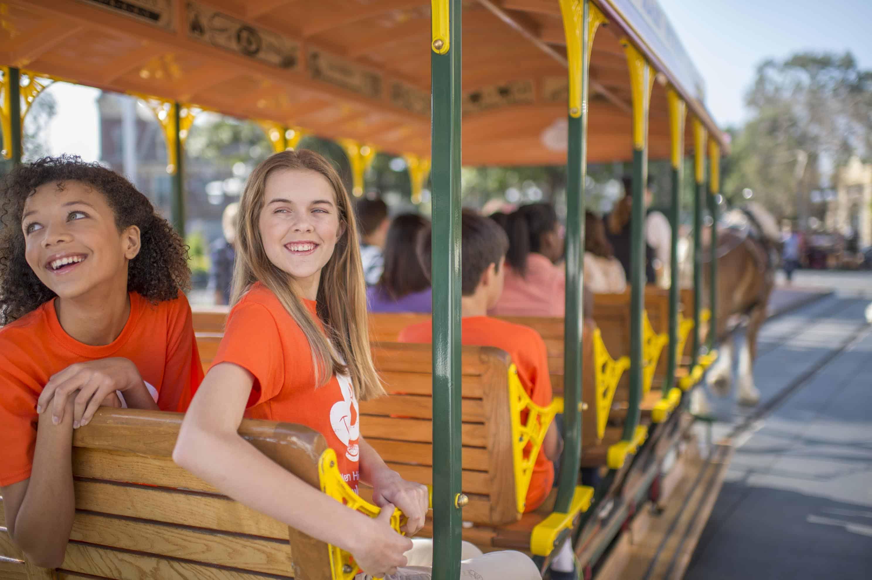 Kids on a Disney Trolley- image by Walt Disney World.