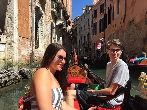 students on a gondola ride in venice