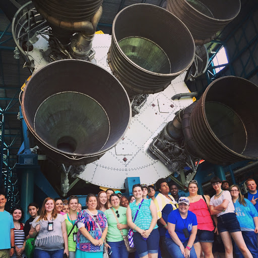 Student group picture with the Saturn V rocket