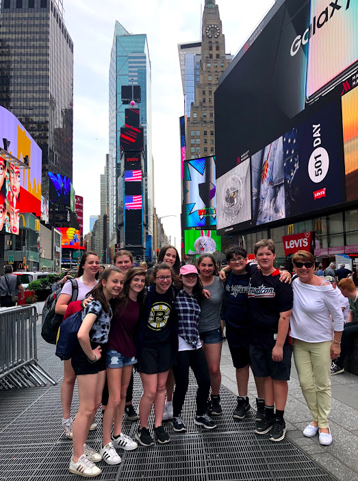 Students posing in Times Square, New York City with GO Educational Tours.