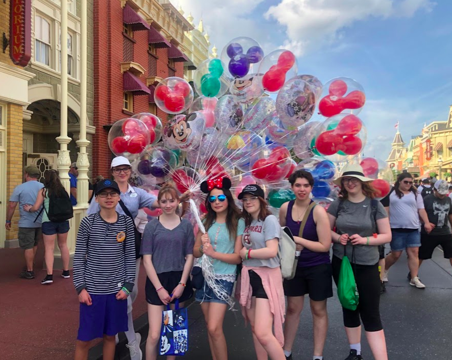 Students at Magic Kingdom with the balloons on Main St.