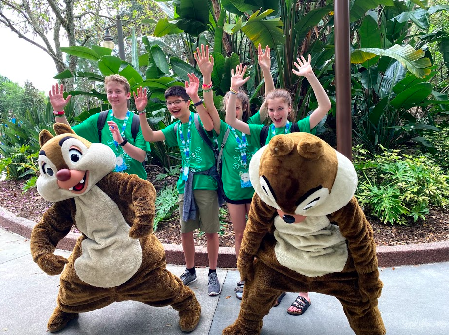 Students posing with Walt Disney World characters Chip and Dale.